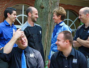 six employees of Blue Plate Catering outside